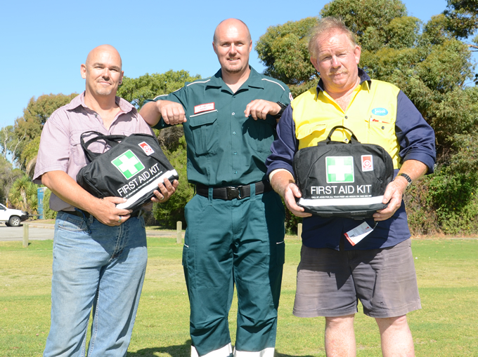 St John Ambulance area manager Marc Van Reenen (centre) presents the first aid kits to John De'Laney (left) and Nigel Lifford